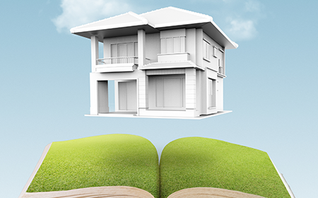 Calculators: The image of a house floating above an open book with pages of grass.